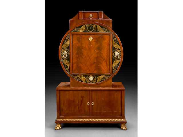 A Viennese Biedermeier parcel gilt and parcel ebonized mahogany secretary