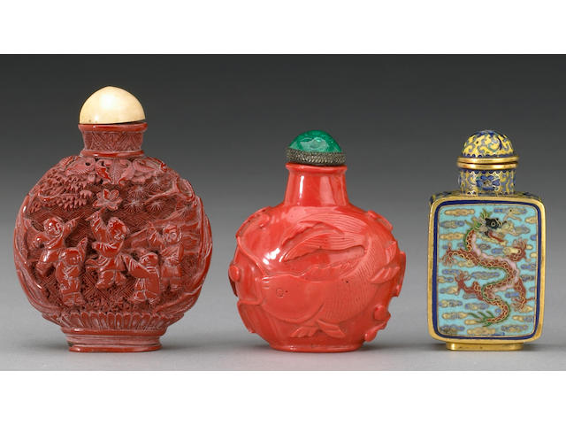 Three snuff bottles, one cinnabar lacquered, one coral and one cloisonne enameled bottle