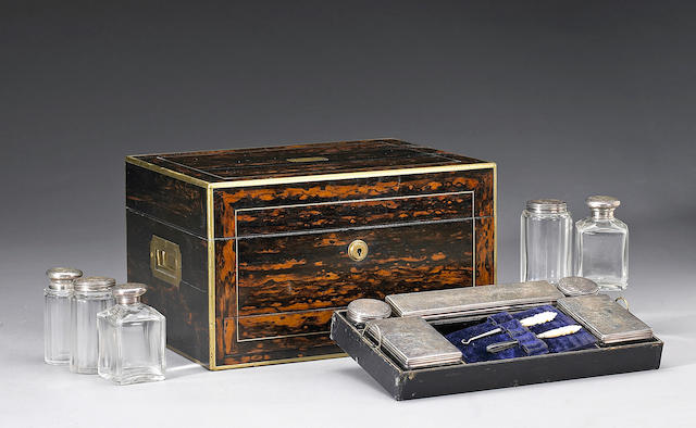 A Victorian calamander toilet box with silver lidded jars