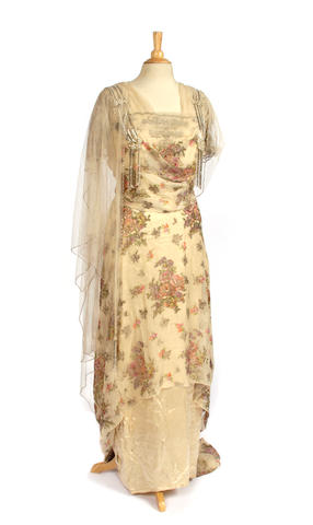 A collection of vintage and antique ladies evening dresses