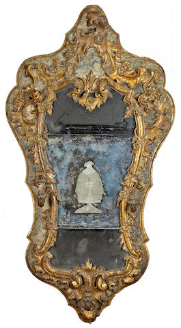 An important Italian Baroque parcel gilt and painted etched mirror