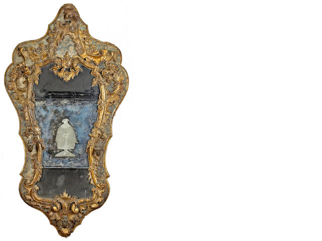 An Italian Baroque parel gilt and paint decorated mirror
