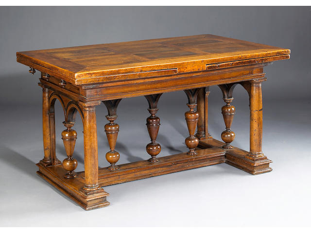 A French Renaissance walnut draw leaf dining table