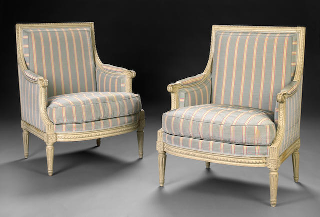 A pair of Louis XVI style paint decorated bergeres
