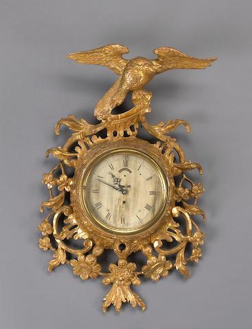 A fine George III giltwood cartel clock
