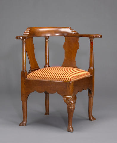 A George III walnut corner armchair