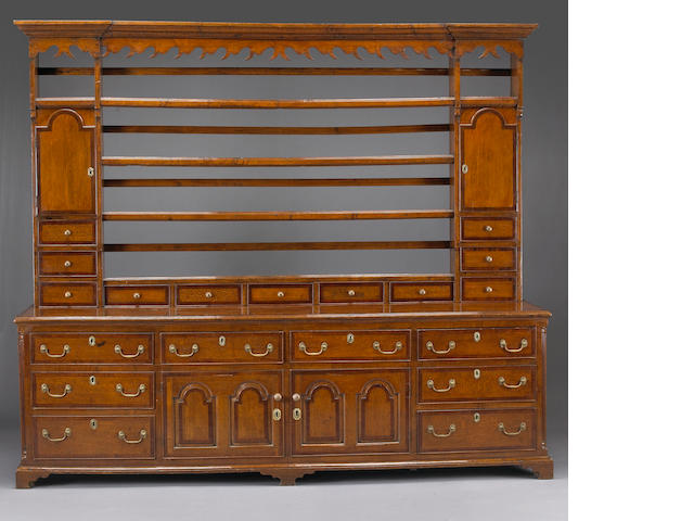 A George III mahogany crossbanded oak high dresser
