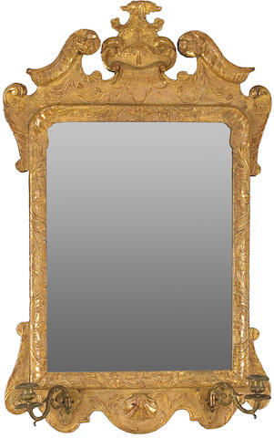 A George I carved giltwood girandole mirror