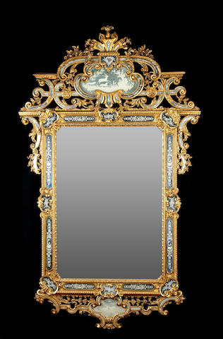 A fine and imposing Italian Rococo style engraved glass and giltwood mirror