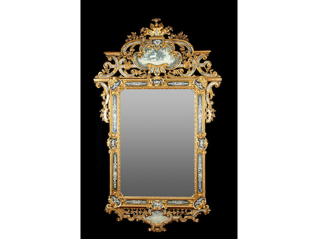 A superb Italian Rococo style giltwood and etched mirror