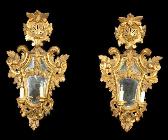 A pair of Italian Neoclassical girandole mirrors
