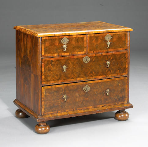 A William and Mary inlaid walnut oyster veneered chest