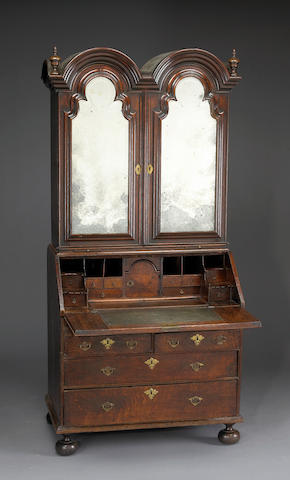 A Queen Anne oak double dome secretary cabinet