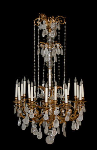 A fine Louis XVI style gilt bronze and rock crystal eighteen light chandelier