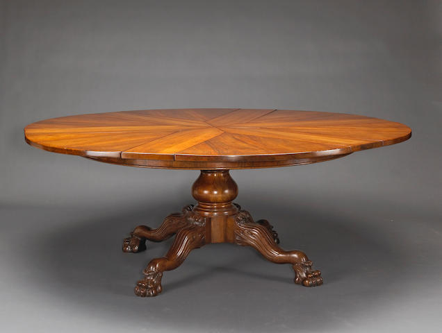 A William IV style walnut concentric extension dining table
