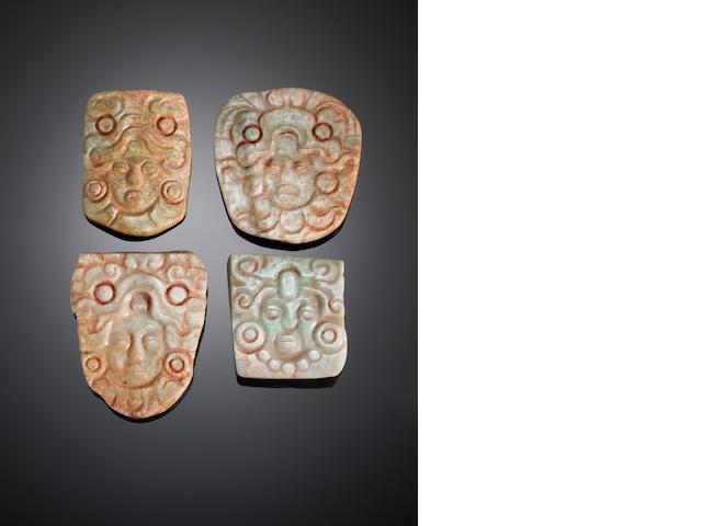 Four Mayan jadeite plaques