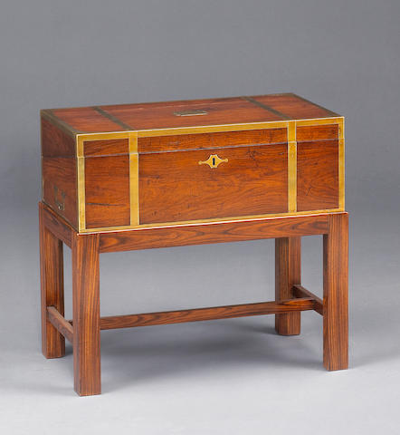 A mahogany brass bound lap desk of American interest on later stand