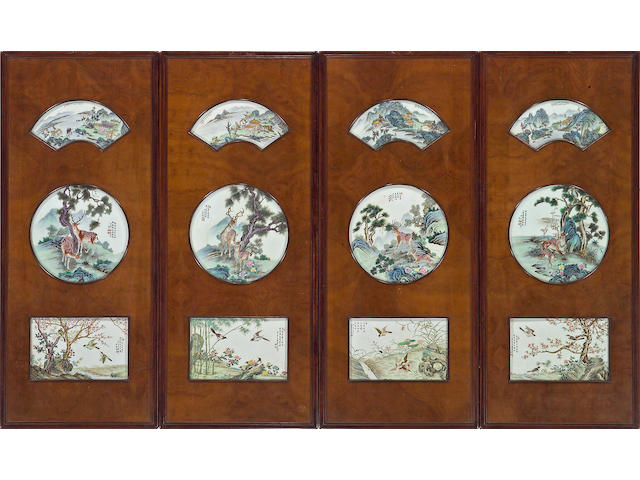 A set of four mixed wood wall panels inset with porcelain plaques 20th Century
