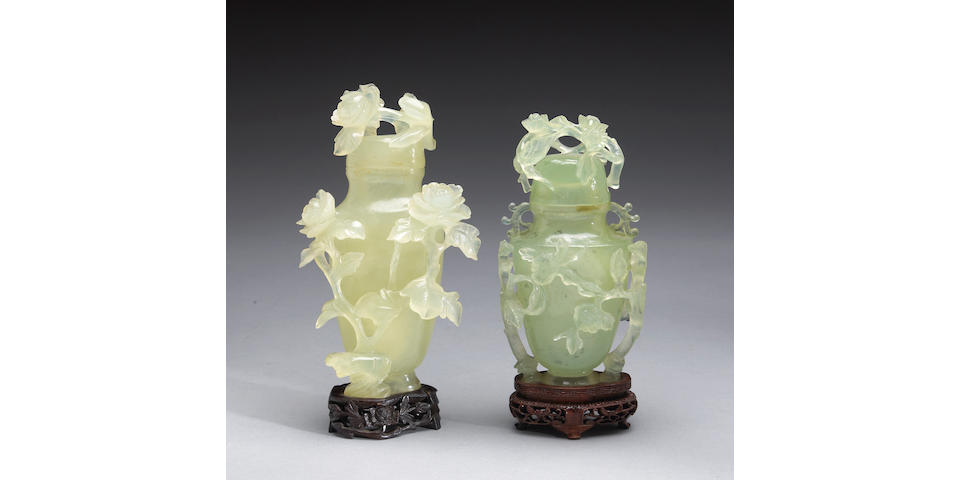 Two carved serpentine covered vases