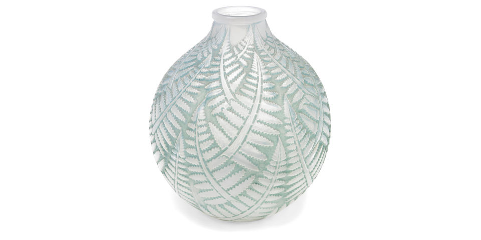 A René Lalique opalascent molded glass vase: Espalion