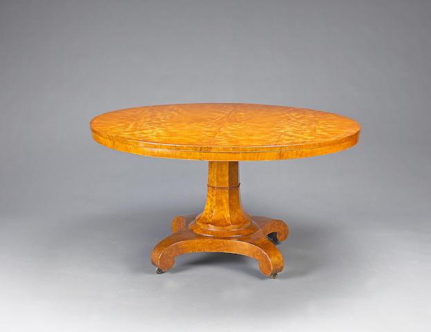 A William IV satinwood tilt top breakfast table