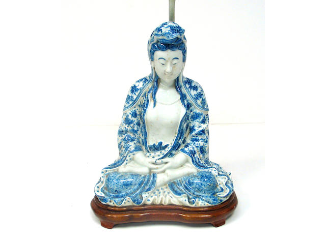 A Chinese blue and white porcelain seated figure of Guanyin 20th Century