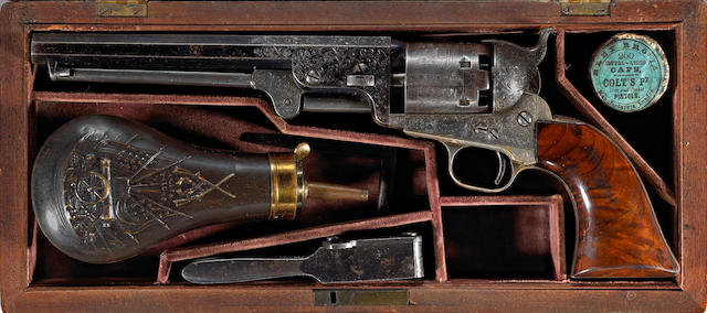 A fine factory cased and Gustave Young engraved Colt Model 1851 Navy percussion revolver