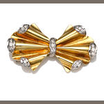 An eighteen karat bicolor gold and diamond brooch, 1940s