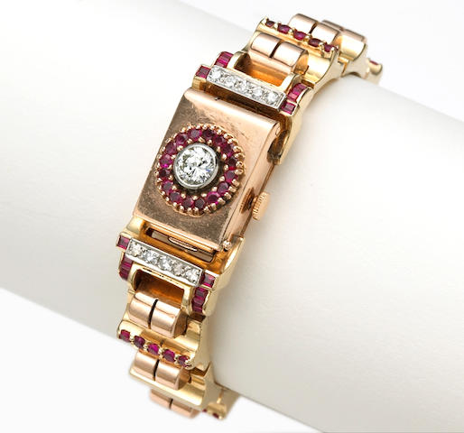 A lady's retro diamond, synthetic ruby, and fourteen karat bicolor gold covered dial wristwatch,