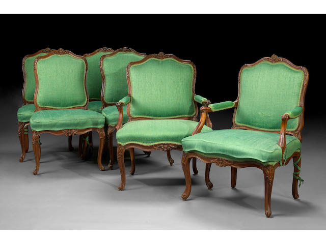 An assembled set of fourteen Louis XV carved beechwood chaises and two fauteuils