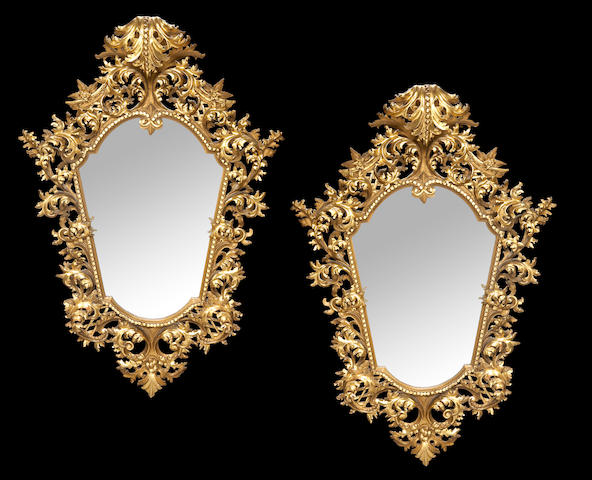A pair of Florentine Rococo style carved giltwood mirrors
