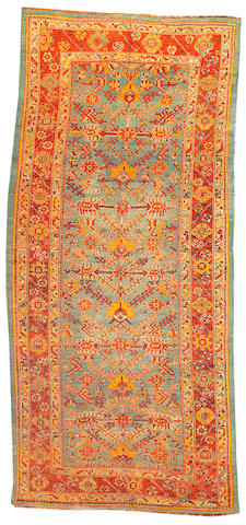 An Oushak rug West Anatolia size approximately 5ft. x 12ft. 10in.