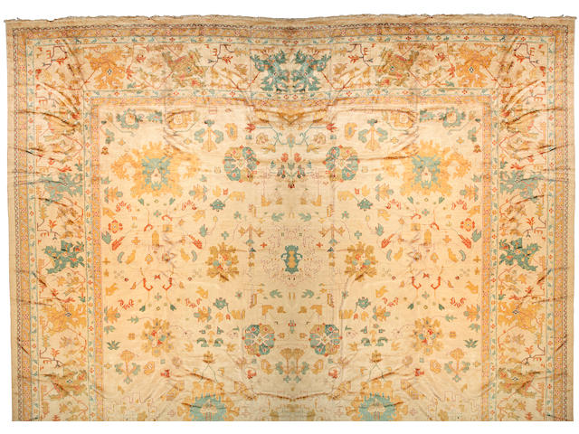 An Oushak carpet West Anatolia, size approximately 19ft. 7in. x 39ft. 5in.