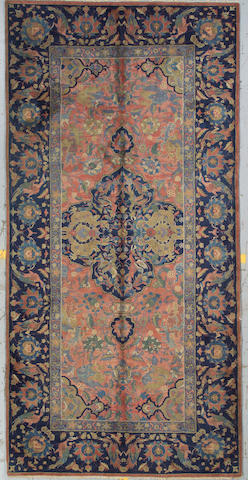 An Indian long carpet size approximately 6ft. x 12ft. 5in.