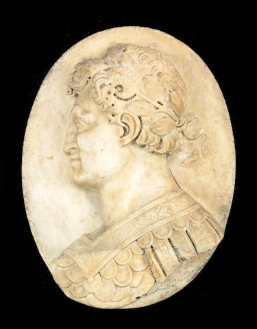 A carved marble oval plaque of a Roman Senator