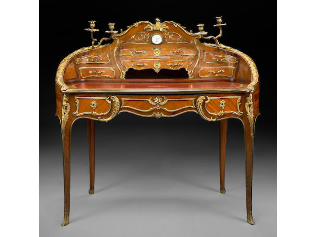 A Louis XV style gilt bronze mounted kingwood desk