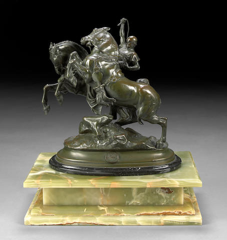 A French patinated bronze equestrian group: Horse Tamer