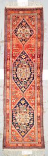 A Malayer runner Central Persia, size approximately 3ft. 5in. x 12ft. 6in.