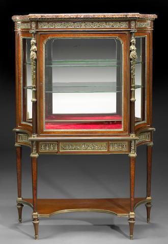 A Louis XVI style gilt bronze mounted vitrine cabinet