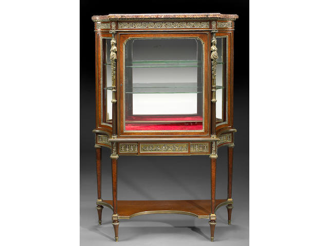 A Louis XVI style gilt bronze mounted amboyna and mahogany vitrine cabinet
