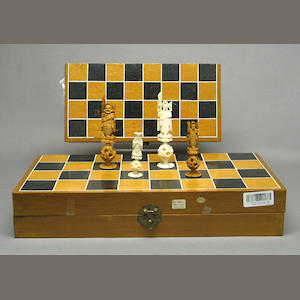Two tinted ivory chess sets 20th Century