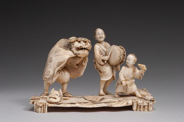 An ivory okimono figural group Meiji/Taisho Period