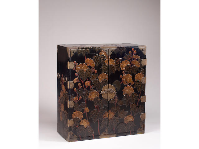 A Japanese lacquer cabinet with peony decoration