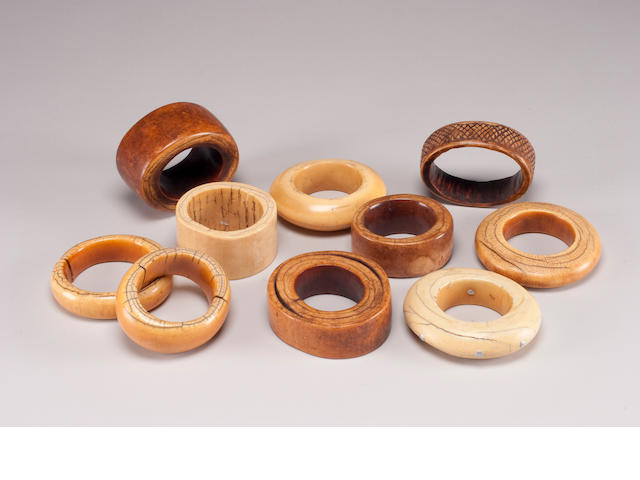 A group of ten African ivory bangles