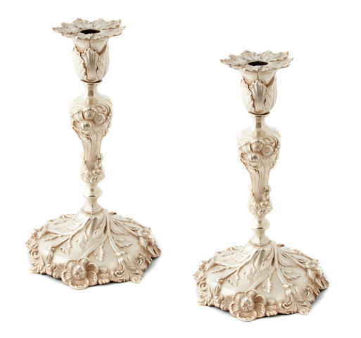 Sterling Pair of Cast Candlesticks with Floral Decoration by Howard & Co.