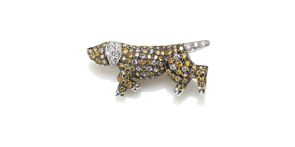A diamond, colored diamond, 18k white and blackened gold dog brooch