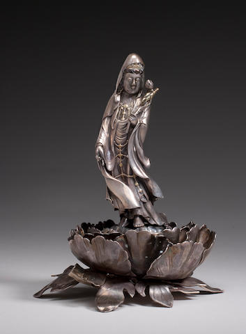 A silver figure of Kannon with gilt accents Meiji Period