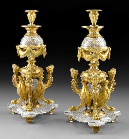A pair of Louis XVI style cut crystal and gilt bronze candlesticks