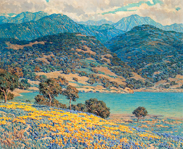 Granville Redmond  (1871-1935) Poppies and lupine by a lake with mountains in the distance 28 3/4 x 35in