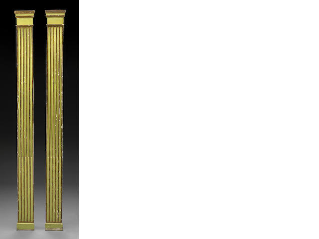 A pair of Continental Neoclassical parcel gilt and paint decorated pilasters